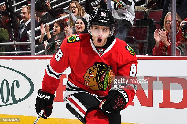 Patrick Kane of the Chicago Blackhawks reacts after scoring against the Philadelphia Flyers in the first period at the United Center on October 18...