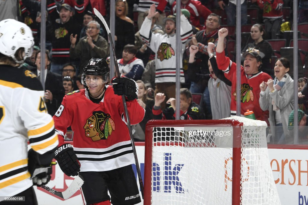 Patrick Kane #88 of the Chicago Blackhawks reacts after scoring against the Boston Bruins in the third period, as his mother Donna cheers (right), at the United Center on March 11, 2018 in Chicago, Illinois.
