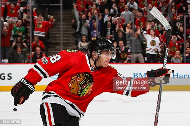 Patrick Kane of the Chicago Blackhawks reacts after scoring the game winning goal in overtime against the Buffalo Sabres at the United Center on...
