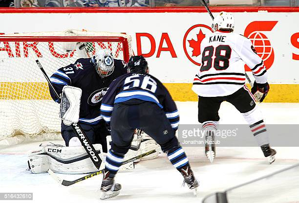 Patrick Kane of the Chicago Blackhawks roofs the puck over goaltender Ondrej Pavelec of the Winnipeg Jets for a second period goal at the MTS Centre...