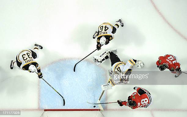 Patrick Kane of the Chicago Blackhawks scores a goal in the first period against Tuukka Rask of the Boston Bruins in Game Five of the 2013 NHL...