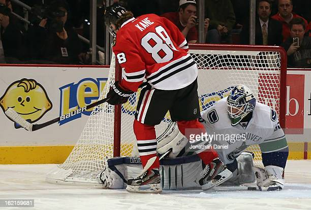 Patrick Kane of the Chicago Blackhawks scores a goal in the shootout against Cory Schneider of the Vancouver Canucks at the United Center on February...