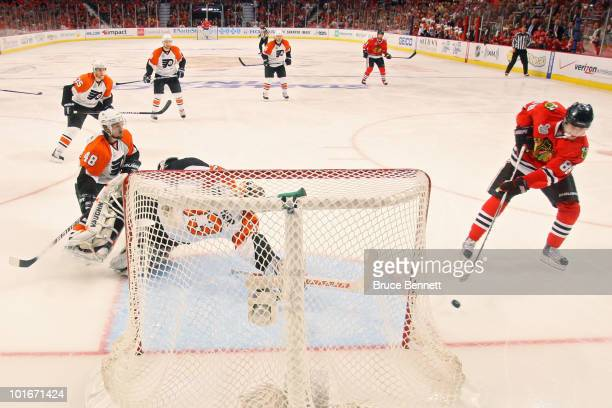 Patrick Kane of the Chicago Blackhawks scores a goal past Brian Boucher of the Philadelphia Flyers in Game Five of the 2010 NHL Stanley Cup Final at...