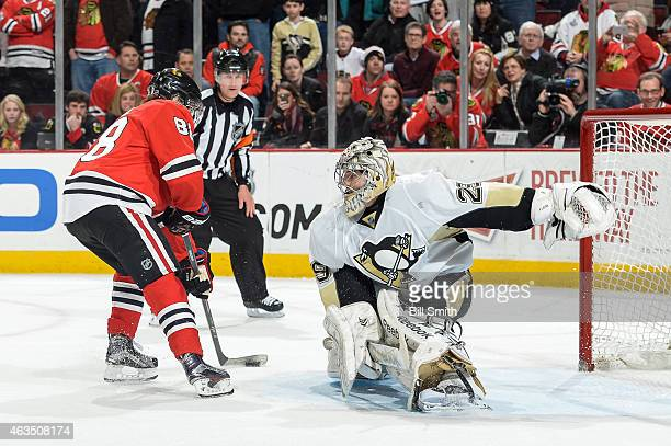 Patrick Kane of the Chicago Blackhawks scores in the shootout against goalie MarcAndre Fleury of the Pittsburgh Penguins during the NHL game at the...