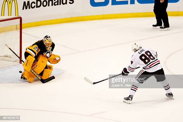 Patrick Kane of the Chicago Blackhawks scores past MarcAndre Fleury of the Pittsburgh Penguins during the shootout at Consol Energy Center on January...
