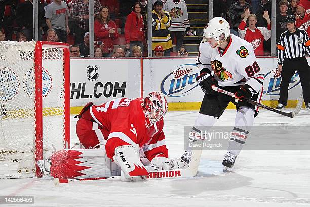 Patrick Kane of the Chicago Blackhawks scores the game winning goal on Jimmy Howard of the Detroit Red Wings in a shootout during an NHL game at Joe...