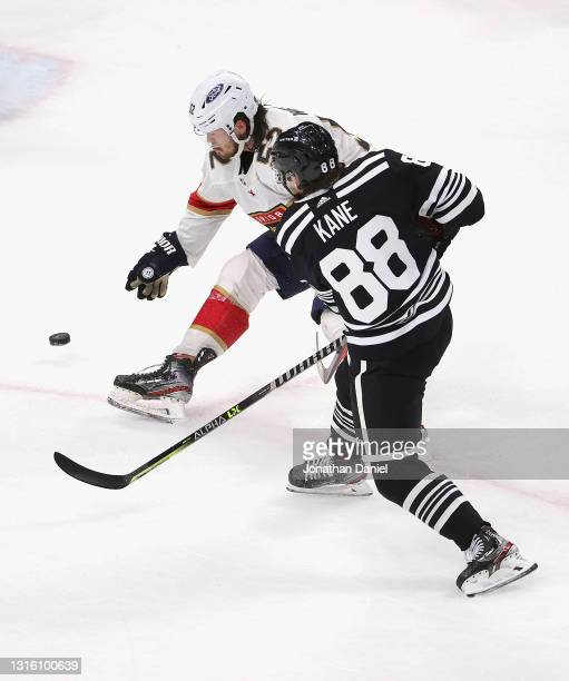 Patrick Kane of the Chicago Blackhawks shoots against MacKenzie Weegar of the Florida Panthers at the United Center on May 01, 2021 in Chicago,...