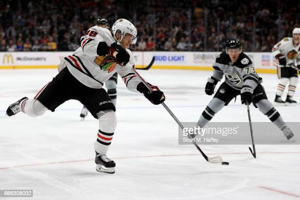 Patrick Kane of the Chicago Blackhawks shoots the puck as Tyler Toffoli of the Los Angeles Kings defends during the third period of a game against...