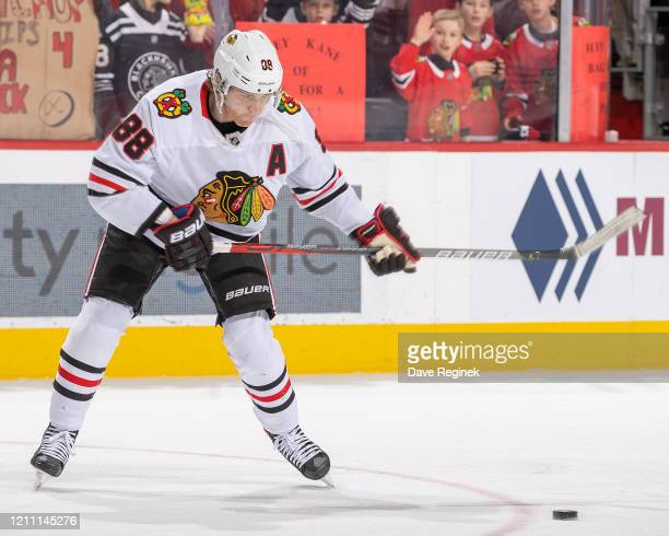 Patrick Kane of the Chicago Blackhawks shoots the puck in warm-ups prior to an NHL game against the Detroit Red Wings at Little Caesars Arena on...