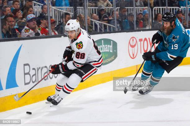 Patrick Kane of the Chicago Blackhawks skates after the puck against Joe Thornton of the San Jose Sharks at SAP Center on January 31 2017 in San Jose...