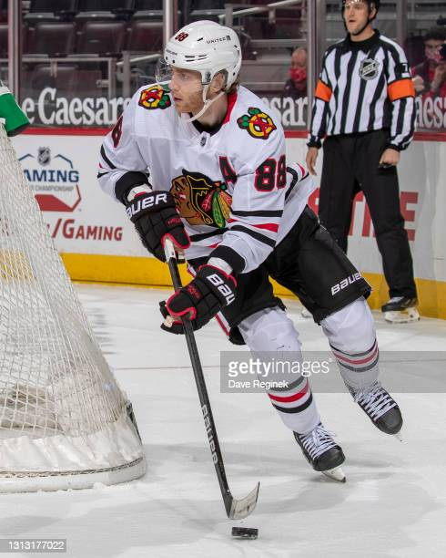 Patrick Kane of the Chicago Blackhawks skates around the net with the puck against the Detroit Red Wings during an NHL game at Little Caesars Arena...