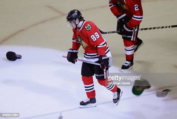 Patrick Kane of the Chicago Blackhawks skates back to the bench after scoring a hat trick on an empty net goal in the third period against the...