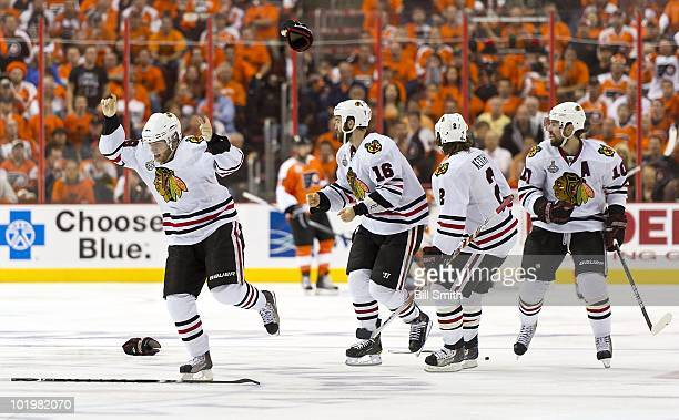 Patrick Kane of the Chicago Blackhawks skates in victory toward goalie Antti Niemi after scoring the winning goal against the Philadelphia Flyers to...