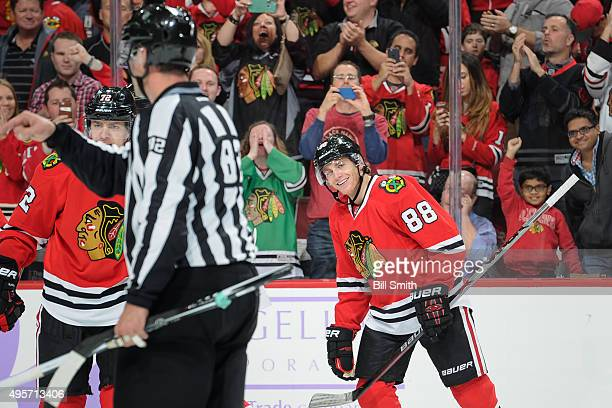 Patrick Kane of the Chicago Blackhawks smiles after scoring against the St Louis Blues in the first period of the NHL game at the United Center on...