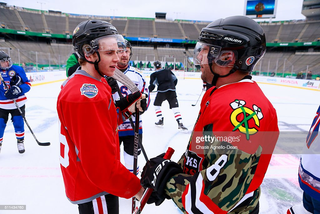 Patrick Kane #88 of the Chicago Blackhawks speaks to a member of the Wounded Warrior hockey team during practice day for the 2016 Coors Light Stadium Series game against the Minnesota Wild at TCF Bank Stadium on February 20, 2016 in Minneapolis, Minnesota.