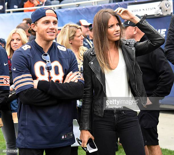 Patrick Kane of the Chicago Blackhawks stands on the sidelines with his girlfriend Amanda Grahovec during warmups prior to the NFL game between the...