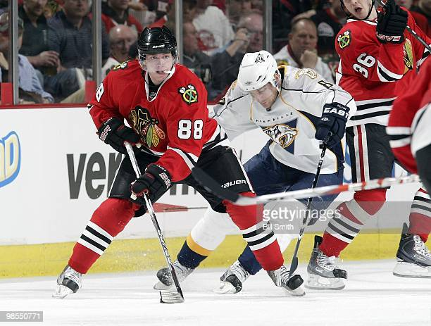Patrick Kane of the Chicago Blackhawks takes control of the puck as Kevin Klein of the Nashville Predators skates up from behind at Game One of the...