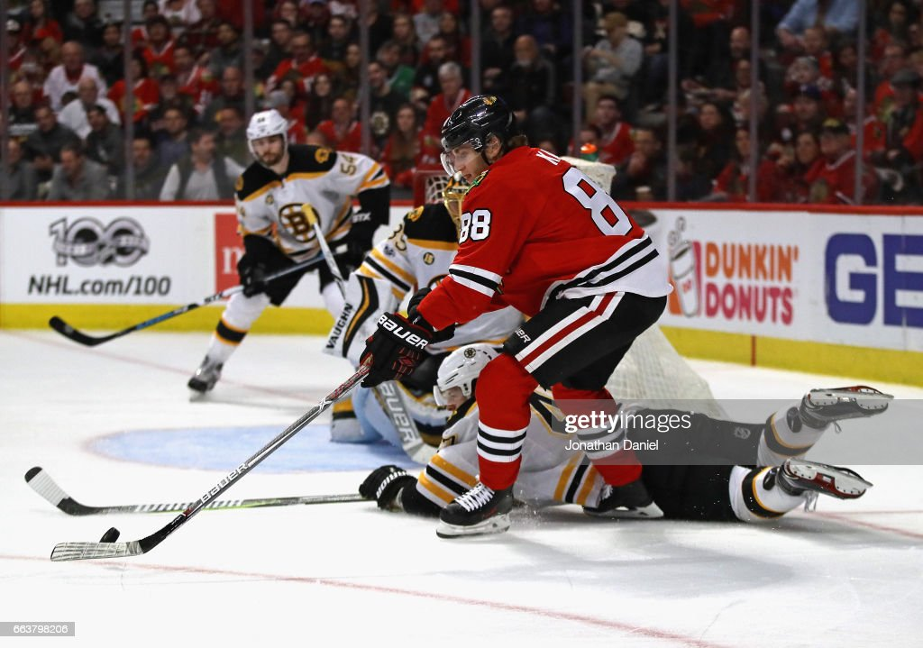 Patrick Kane #88 of the Chicago Blackhawks tries to get off a shot as Torey Krug #47 of the Boston Bruins drops to block in the second period at the United Center on April 2, 2017 in Chicago, Illinois.