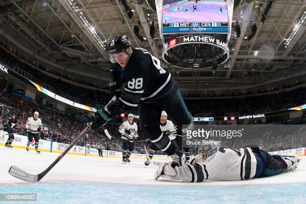 Patrick Kane of the Chicago Blackhawks trips over Braden Holtby of the Washington Capitals during the 2019 Honda NHL AllStar Game at SAP Center on...