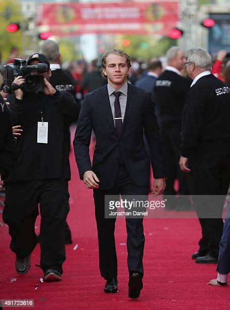 Patrick Kane of the Chicago Blackhawks walks down the red carpet before the first home game against the New York Rangers during an NHL game at the...