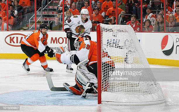 Patrick Kane of the Chicago Blackhawks watches his game winning goal go past Michael Leighton of the Philadelphia Flyers in Game Six of the 2010 NHL...