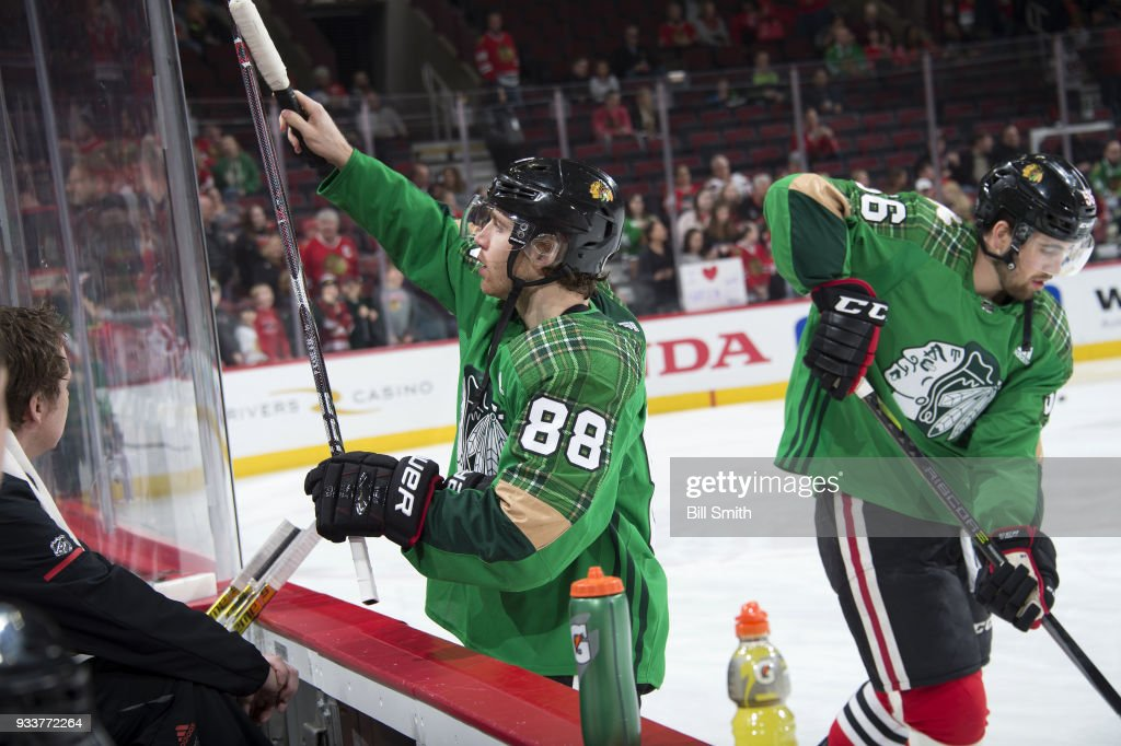 best website 5aece 6c836 Patrick Kane of the Chicago Blackhawks wears a green jersey ...