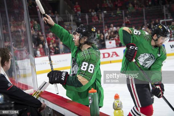 Patrick Kane of the Chicago Blackhawks wears a green jersey during warmups to celebrate St Patrick's Day prior to the game against the St Louis Blues...