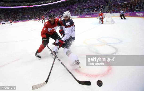 Patrick Kane of the United States challenges Duncan Keith of Canada for the puck during the Men's Ice Hockey Semifinal Playoff on Day 14 of the 2014...