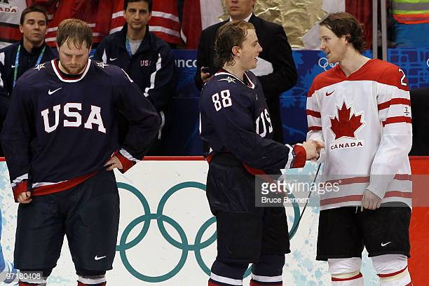 Patrick Kane of the United States shakes hands with Duncan Keith of Canada prior to receiving the medals during the ice hockey men's gold medal game...