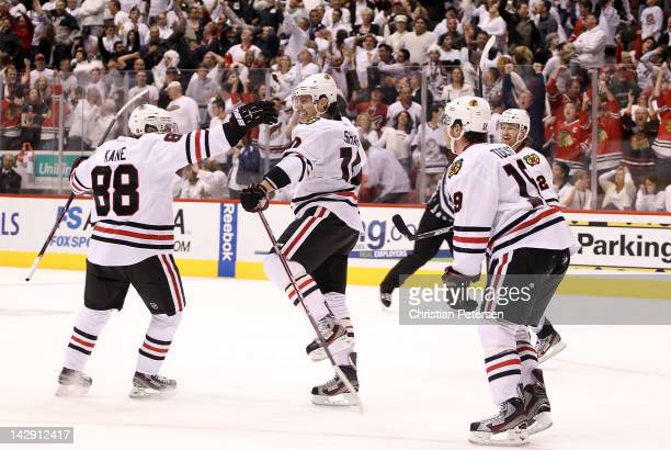 Patrick Kane Patrick Sharp Jonathan Toews and Duncan Keith of the Chicago Blackhawks celebrate after Sharp scored the game tying goal against the...