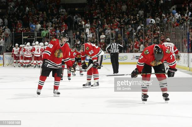 Patrick Kane Tomas Kopecky and Brent Seabrook of the Chicago Blackhawks skate back to the bench after losing to the Detroit Red Wings on April 10...