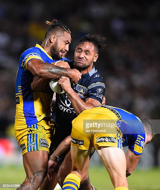 Patrick Kaufusi of the Cowboys is tackled by Kenny Edwards and Kieran Foran of the Eels during the round eight NRL match between the North Queensland...