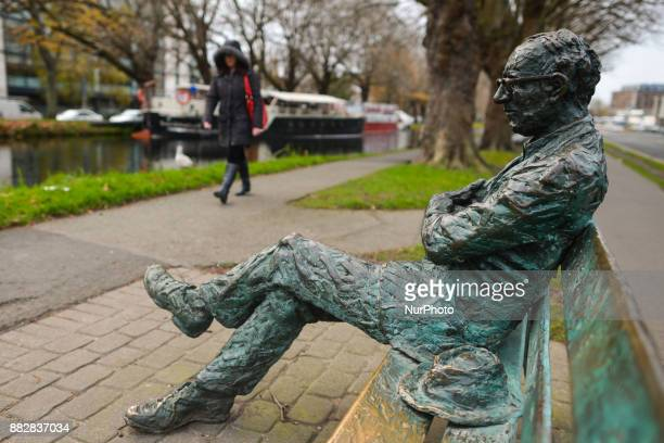 Patrick Kavanagh statue along the Grand Canal in Dublin on the day of the 50th Anniversary of his death Kavanagh was an Irish poet and novelist His...