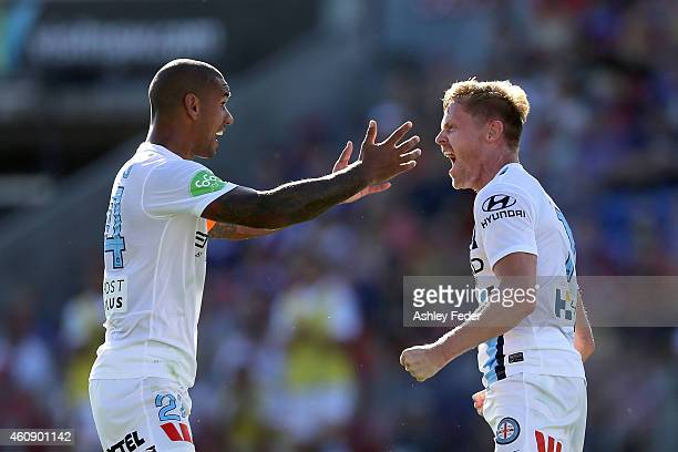 Patrick Kisnorbo and Damien Duff of Melbourne City FC celebrate Melbournes third goal during the round 14 A-League match between the Newcastle Jets...