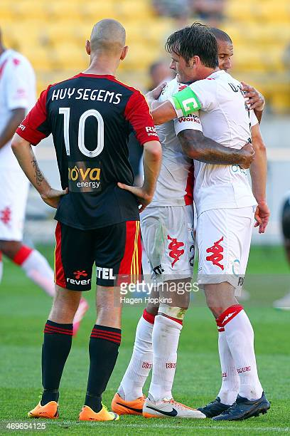 Patrick Kisnorbo and Rob Wielaert of the Heart congratulate each other after the final whistle while Stein Huysegems of the Phoenix looks on during...