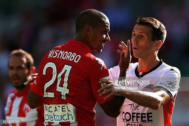 Patrick Kisnorbo of Melbourne and Liam Miller of Brisbane share a conversation during the round 20 ALeague match between Melbourne Heart and Brisbane...