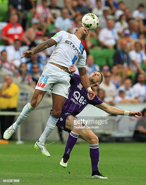 Patrick Kisnorbo of Melbourne City and Andy Keogh of Perth Glory compete for the ball during the round 18 ALeague match between Melbourne City FC and...