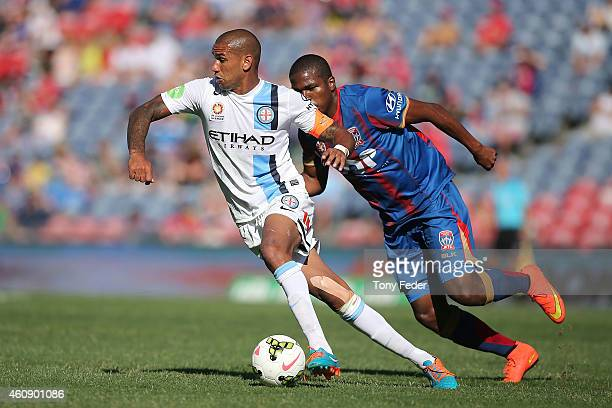 Patrick Kisnorbo of Melbourne City contests the ball with Edson Montano of the Jets during the round 14 ALeague match between the Newcastle Jets and...