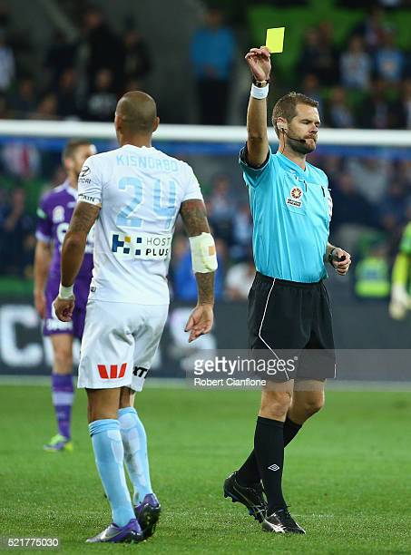 Patrick Kisnorbo of Melbourne City is shown the yellow card by referee Chris Beath during the ALeague Elimination Final match between Melbourne City...