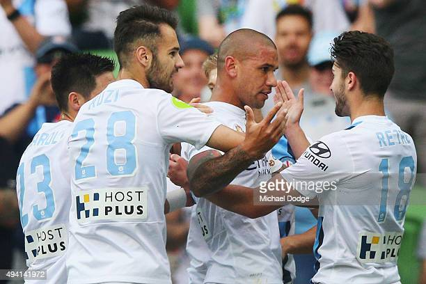 Patrick Kisnorbo of the City celebrates a goal with teamates during the round three ALeague match between Melbourne City FC and the Central Coast...