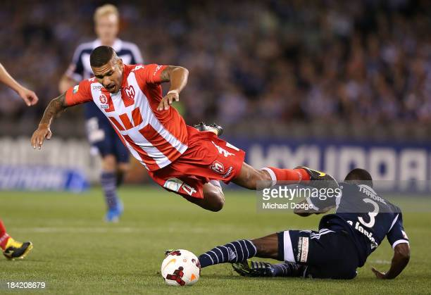 Patrick Kisnorbo of the Heart and Adama Traore of the Victory contest for the ball during the round one ALeague match between the Melbourne Victory...