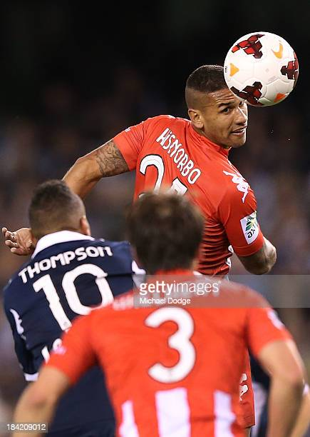 Patrick Kisnorbo of the Heart headers the ball during the round one ALeague match between the Melbourne Victory and the Melbourne Heart at Etihad...