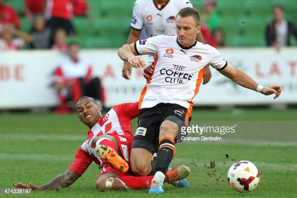 Patrick Kisnorbo of the Heart tackles Besart Berisha of the Roar during the round 20 ALeague match between Melbourne Heart and Brisbane Roar at AAMI...