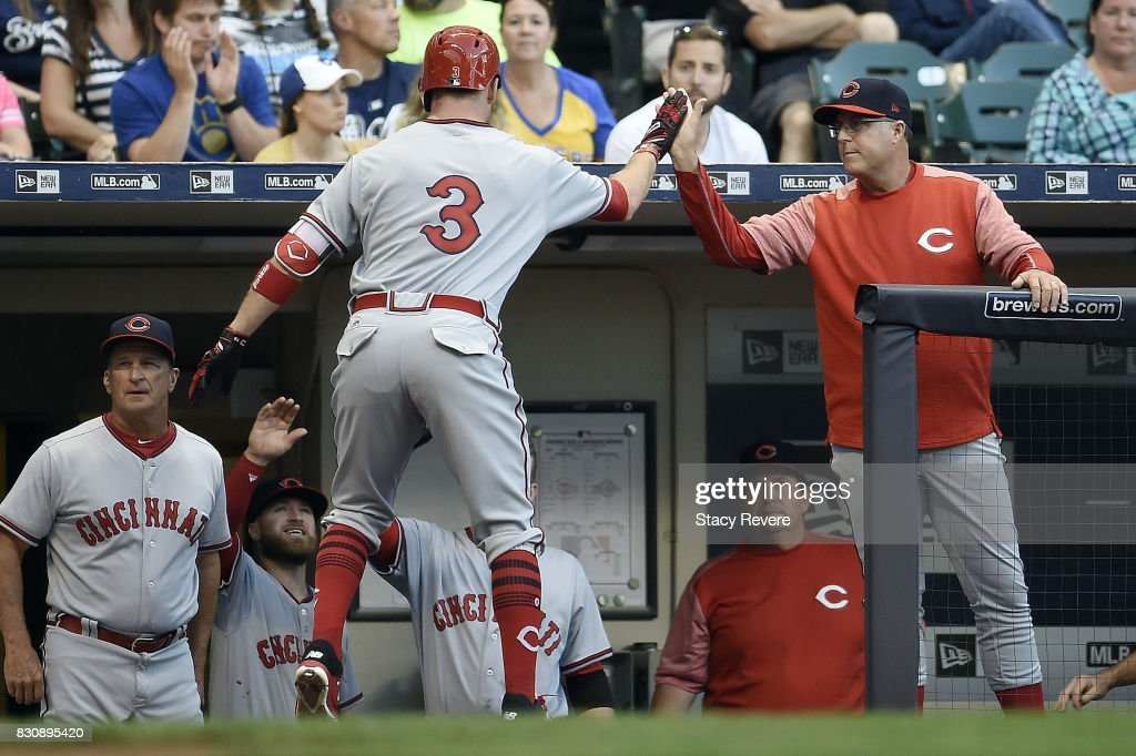 Patrick Kivlehan #3 of the Cincinnati Reds is congratulated by manager Bryan Price #38 following a two run home run against the Milwaukee Brewers during the fourth inning at Miller Park on August 12, 2017 in Milwaukee, Wisconsin.