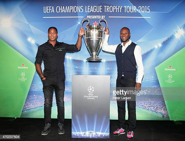 Patrick Kluivert and Eric Abidal hold the trophy at the UEFA Champions League Trophy Tour presented by Heineken Dallas Stop at Clive Warren Park...