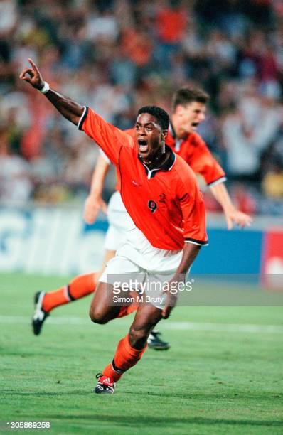 Patrick Kluivert of Holland celebrates after scoring during the World Cup Semi Final between Brazil and Holland at the Orange Velodrome on July 07,...