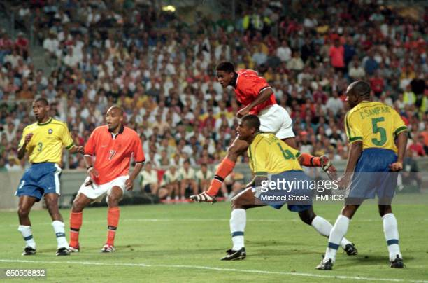 Patrick Kluivert of Holland leaps unchallenged to score the equalising goal with three minutes left
