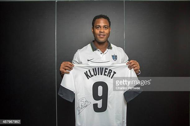 Patrick Kluivert poses with a tshirt at a Global Legends Series media event on October 27 2014 in Kuala Lumpur Malaysia