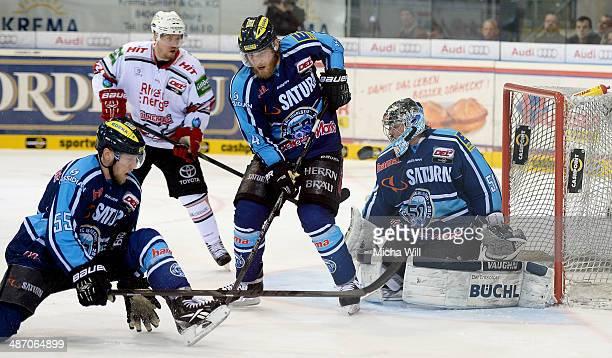Patrick Koeppchen and Tim Conboy of Ingolstadt defend Timo Pielmeier's goal in game six of the DEL final playoffs between ERC Ingolstadt and Koelner...