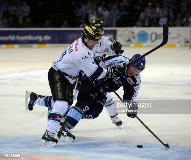 Patrick Koeppchen of Hamburg challenges for the puck with Joseph Motzko of Ingolstadt during the DEL ice hockey game between Hamburg Freezers and ERC...